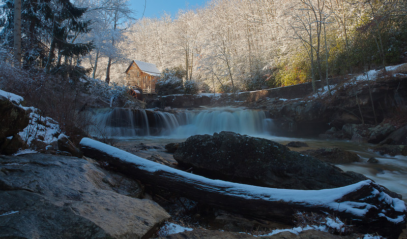 Glade Creek Gristmill<br /> <br /> This is a remake, it is the first shot since I fell just upstream and broke the 15-35 mm off the front of the camera, the glimmer on the rocks is a shean of ice from the deep freeze the night before. I can't go out any further to the water because its so slick, and i'm hurt, I went ass over teakettle in a big way and am just now functioning.<br /> <br /> America the Beautiful.....this is one of my favorite places.<br /> <br />  Critique welcome. <br /> <br /> This mill can be found in Babcock State Park, West Virginia.....ask them if they found my lens and a chunk of my pride.