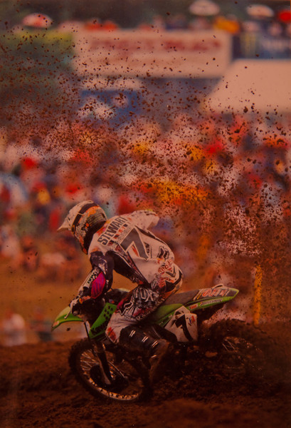"Motocross phenom James Stewart....<br /> <br /> Described by the fastest man on two wheels Ricky Carmichael during our interview....""I'm the fastest man on two wheels...James is from another planet."" This photo taken at Redbud Michigan shows the roost encircling James as he catapults out of the corner.<br /> <br /> So... i have been working with the  scanner and the guy at b-b told me off i didn't think the scanner was that good to take a picture of the picture with my digital camera in good light then compare that image to the scanned one....camera wins!  Although this is a crude quick version of this shot it took me less than five minutes to set the 8x10 up in some good light and real off a shot. the original was taken with a Canon 200mm 1.8 lens on a Canon A2E body at 1200....it was almost raining. Since i have just converted over to digital only four months ago i want to process some of the awesome shots i have in the box already.....help me figure it out....point out the bad ...and the good. Your help is appreciated."