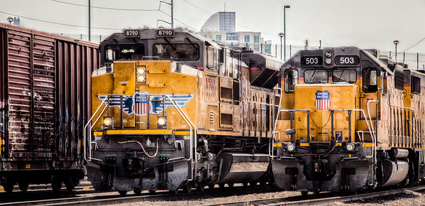 30APR2014  Old and New  Shot this a couple weeks ago next to the Union Pacific's North Omaha yard.  Loco 8790 rambles up to the petroleum terminal as 503 sits idling through lunch.  Thanks for the wonderful comments….if any of y'all are visiting for the Berkshire Hathaway stockholders meeting this weekend the Omaha Camera Club is exhibiting at the Hot Shops across from the Century Link Center……stop by and take a look.  Have a great day!