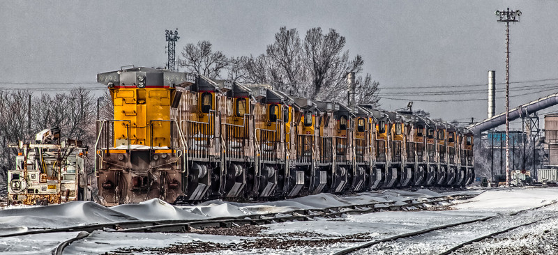 19FEB2014  Lotta Locos  In the Union Pacific Council Bluffs Iowa rail yard a few weeks ago…..where our trouble started.  Thanks Bruce, if you like this one you can use it for the calendar entry if you like.  Cold with an overcast sky…great light to shoot in, and it is starting to snow.  Have a great day….is it Kyle Bush's year to win the cup? Go KB!  Thanks for the comments!