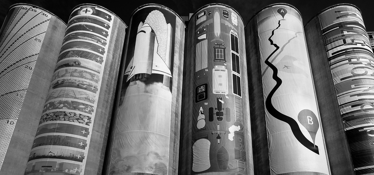 30JAN2013<br /> <br /> Scenic Silos<br /> <br /> These banners are hung on the side of a now closed grain elevator just southwest of downtown Omaha Nebraska. The banners are about a hundred feet long by twenty feet wide. <br /> <br /> Happy Birthday goes out to my brother Tom today.<br /> <br /> It took me a bit to process this, quite a challenging place to shoot. Please let me know if i'm on the right track, leave me a comment.