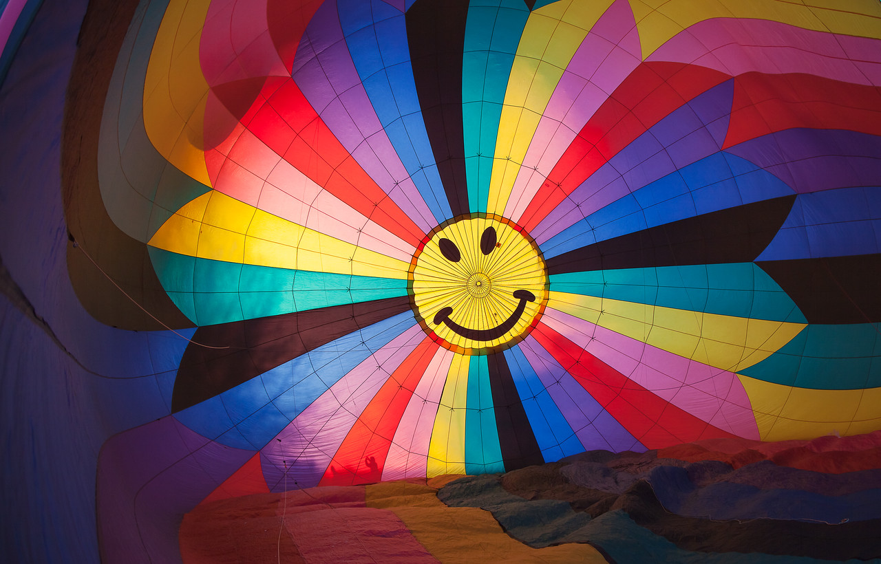 07FEB2013<br /> <br /> Colorful Smile<br /> <br /> Looking into the balloon canopy during deployment.<br /> <br /> I think it was so cold a bic lighter could have got this into the air!<br /> <br /> Smile.....leave me a happy comment!