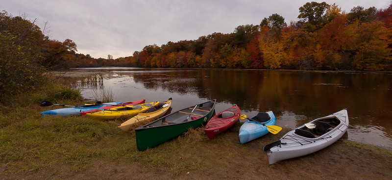 07OCT2012<br /> <br /> Lakeside Flotilla<br /> <br /> Behind me is one hundred screaming kids on a field trip to Mirror Lake Wisconsin a State Park just south of the Wisconsin Dells. Not a likely day to go Kayaking it's forty two degree's out and the wind is whipping. None the less the tykes boarded the crafts and sped of to the nether reaches of the lake....we just happened by the park on our hunt for Fall foliage.<br /> <br /> Thanks for all the wonderful comments yesterday....What do you think of this one?<br /> <br /> Husker Nation is Bummed out...i'm not going to Ohio this week. Have a great Sunday!<br /> <br /> There was a few instructors there to put the gear into the water for the kids...In fact he asked me if he had lined those up good enough for my shot....crazy huh... you just have to get out there amongst them Badgers, their harmless!