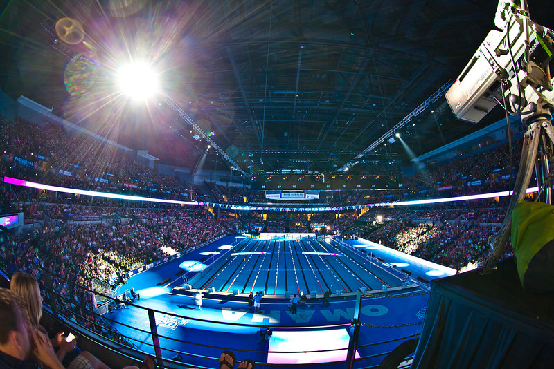 01JULY2012<br /> <br /> Date Night....<br /> <br /> Best seat in the house, my chair is the one next to the NBC camera, centered on lane five.....how does this happen?<br />   <br /> Hand held with my 8-15mm... the lights are going crazy and the crowd is rocking! Mr. Phelps is up soon for a final...<br /> <br /> I hope she had a great time....I know I did, thank you. It was amazing we both worked hard and planned this photo shoot. Teamwork and proper seat choice was how this shot happens.....and some dumb luck. The other shots with the 200mm 1.8 are much better, the lens I lost last year surely would have been easier to use but this lens is challenging my resolve, we really expected to get tossed out carrying in a big lens let alone a tripod which I did not bring...we had all the crap we needed however next time it's coming with!<br /> <br /> Please comment! Have a great Sunday.