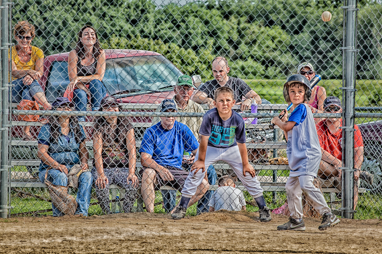 "05JUL2013<br /> <br /> Future Home Run<br /> <br /> Our little buddy.....at the ball field.<br /> <br /> He has his eye right on that ball.....the catcher is wondering, will he hit it....the crowd seems to approve.<br /> <br /> Processed in Lightroom 4... a single image uploaded to HDR effects pro 2.....lots of good stuff smeared all over it..... then put back into Lightroom 4 for detail (noise reduction.)<br /> <br /> I had someone tell me the other day.....""it looks so Herman Rockefeller""...lol....made my day!<br /> <br /> Have a great day!"