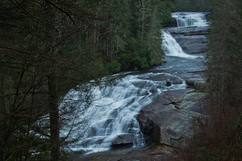 19DEC2011<br /> <br /> Triple Falls North Carolina...in the rain.<br /> <br /> Thanks for all the awesome comments on yesterday's picture, trip co-ordinator and cancer thriver Linda Davis deserves much of the credit. Triple Falls is a 1220' accent and 3.2 miles round trip, this was her second back-country hike into active bear country....she did amazing!!!!<br /> <br /> Our twelve day trip to the east coast is over and the Grandkids are in tomorrow for the next month....have lots to process and share.<br /> <br /> Make it a great week!