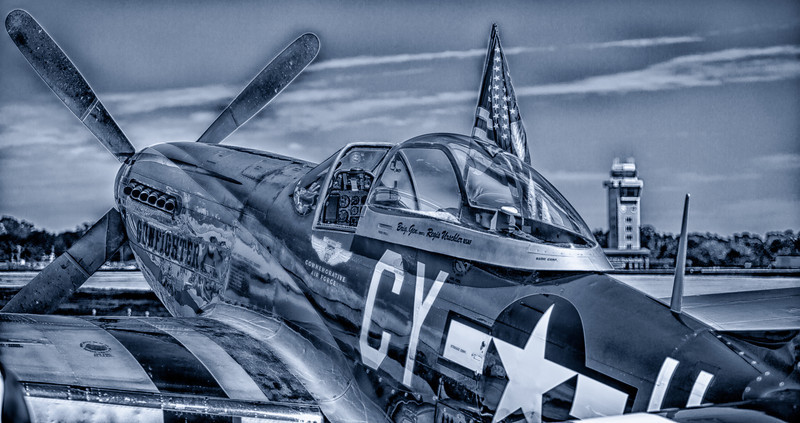 08APR2013<br /> <br /> Bad Ride<br /> <br />  A Mustang at the 911 Air Show in Lincoln Nebraska..... with some NIK HDR effects 2 smeared all over it!<br /> <br /> Working the new software.....hows it look, kind of fits my style.....I hold a high performance single engine rating currently, AP/IA as  well.<br /> <br /> Please leave me a comment, thanks!