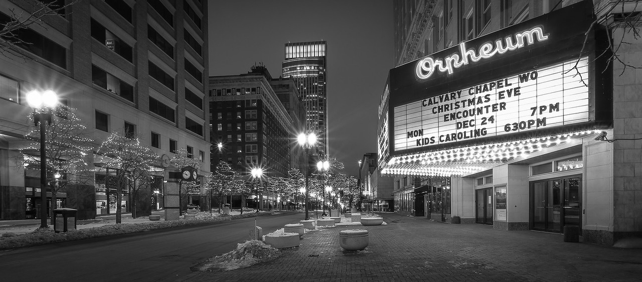 "24DEC2012<br /> <br /> Sound Of Music<br /> <br /> Bitterly cold the town seemed empty except for the everstreaming sounds of praise and glory coming from the open door of the Orpheum as I passed by searching for long exposure night images of downtown Omaha Nebraska. The Orpheum is over a hundred years old and still has live broadway theater, performance rentals and children's dance productions....and of course Caroling.<br /> <br /> Just a quick note to say thanks to all the wonderful people who stop here to look at some of my images this year.....your comments help me get better, thank you for sharing your work.....not only have I got better at Image composition but processing as well, wishing you all a great year in digital photography!<br /> <br /> My Image yesterday ""Log Cabin Lake"".....a dad crop from Wisconsin can be found in Marinette County about a mile south of Hwy. 8 on Lily Lake road.<br /> <br /> Merry Christmas ......and to all a good night."