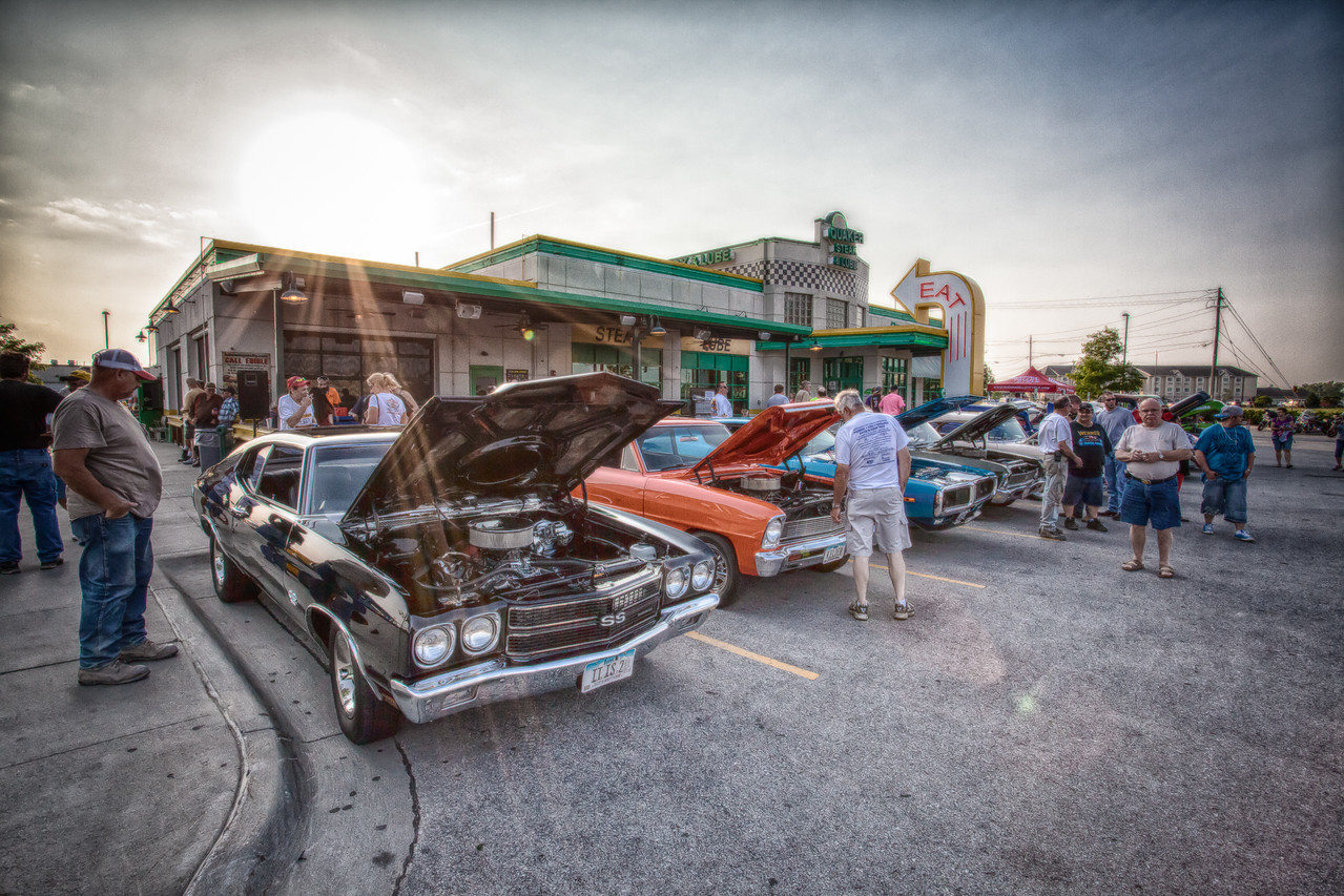 21JUN2013<br /> <br /> Quaker Steak <br /> <br /> One of the larger car shows in the area is over in Council Bluffs Iowa.<br /> <br /> It's hot.....but things are lookin cool.<br /> <br /> People always are looking at what you are doing with that camera.<br /> <br /> Thanks for looking at my work today!