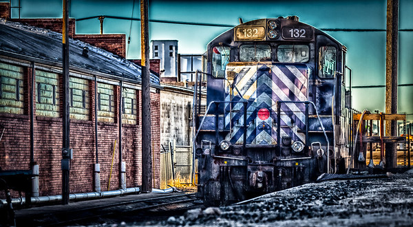 30JAN2014  Mile Zero  Sitting at the yard station in downtown Billings Montana loco 132 idles as the morning sun crest the tops of the buildings.  Thanks for looking at my work today.