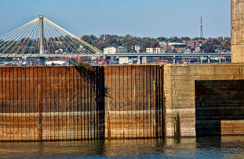 Alton, Illinois in the background of the lock and dam just outside Riverlands Migratory Bird Sanctuary. One side of the bridge is in Illinois and the other Missouri. You can see part  of the Clark Bridge on the left. 4.5.13 Have a great weekend.
