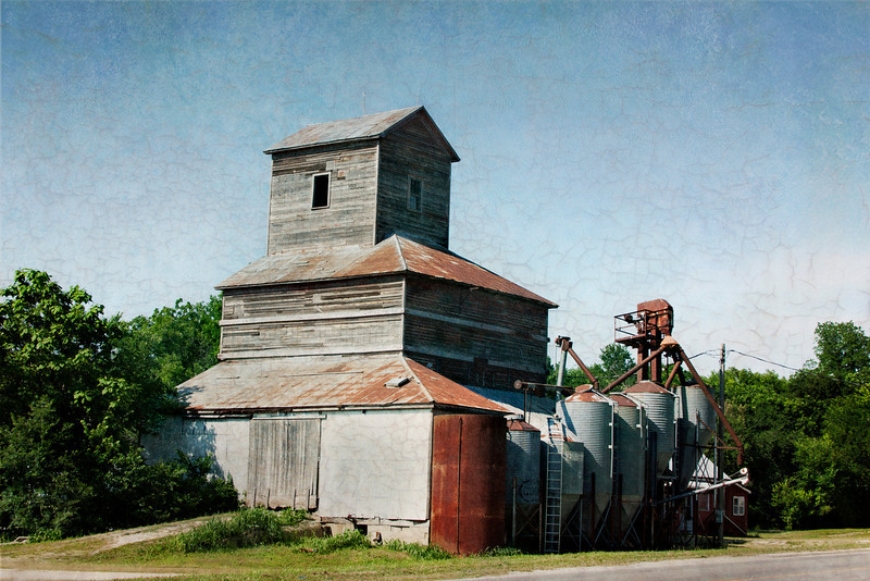 This is the old seed elevator on the edge of town in Calhoun, Missouri. I passed by this place twice a day during the school year for 12 years as a kid. Funny, it looks about the same. I'm not sure if it is still in use, but looks better structurally than some of the houses in town.