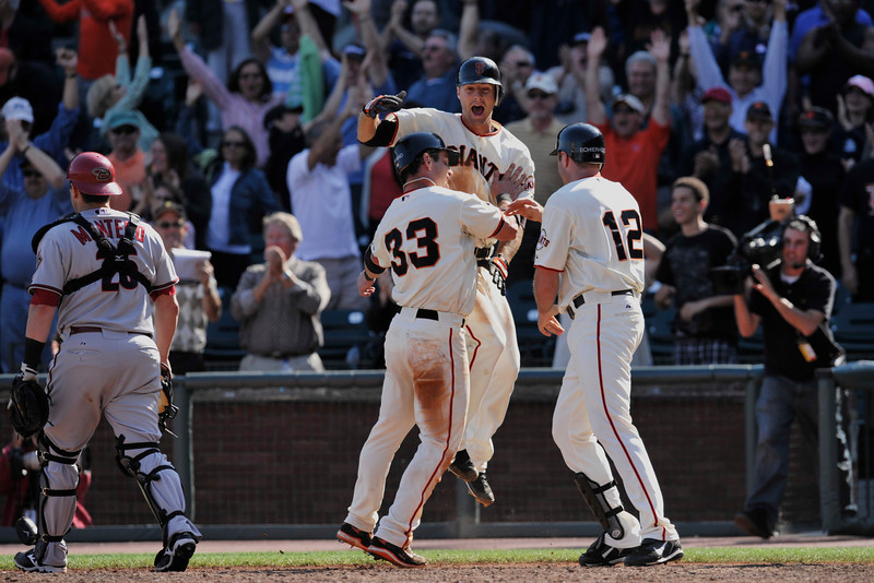 10 September 2008:  San Francisco Giants shortstop Ryan Rohlinger (57) celebrates as Aaron Rowand (33) scores the winning run in the bottom of the ninth inning with two outs during the Giants' 4-3 win over the Arizona Diamondbacks at AT&T Park in San Francisco, CA.