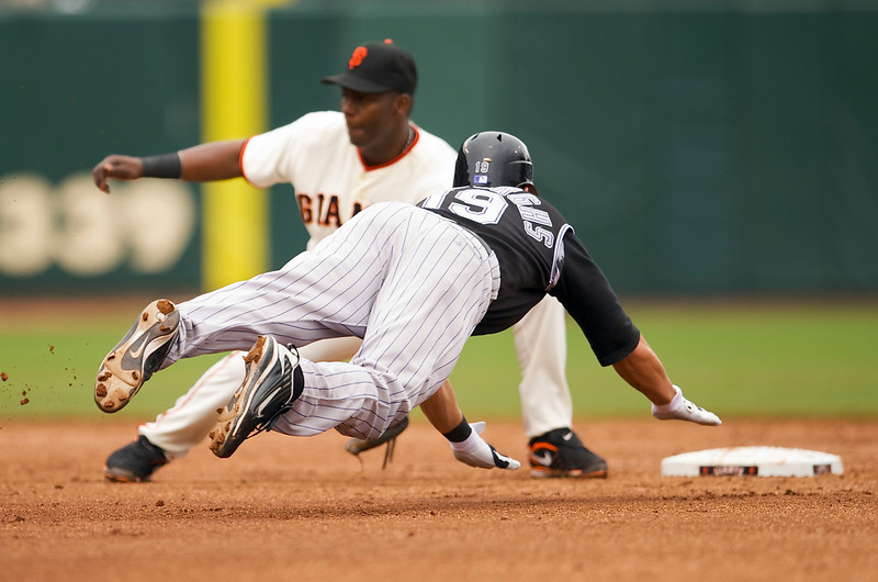02 May 2009:  Colorado Rockies right fielder Ryan Spilborghs (19) steals second base with a dive to the bag as San Francisco Giants shortstop Edgar Renteria (16) receives the throw during the Rockies' 5-1 win over the Giants at AT&T Park in San Francisco, CA.