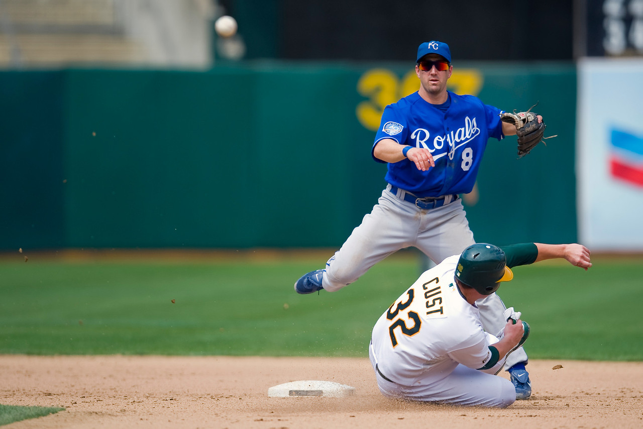 02 September 2009:  Kansas City Royals right fielder Willie Bloomquist (8) turns a double play over a hard slide by Oakland Athletics designated hitter Jack Cust (32) during the Athletics' 10-4 win over the Royals at Oakland-Alameda County Coliseum in Oakland, CA.