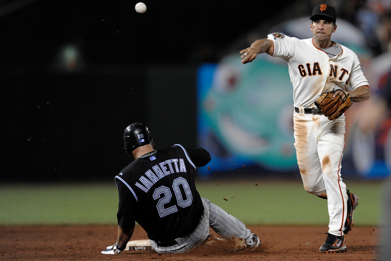 27 August 2008: Omar Vizquel (13) catches the ball bare-handed, turning the double-play to end the game as Chris Iannetta (20) slides into second base during the San Francisco Giants' 4-1 victory over the Colorado Rockies at AT&T Park in San Francisco, CA.