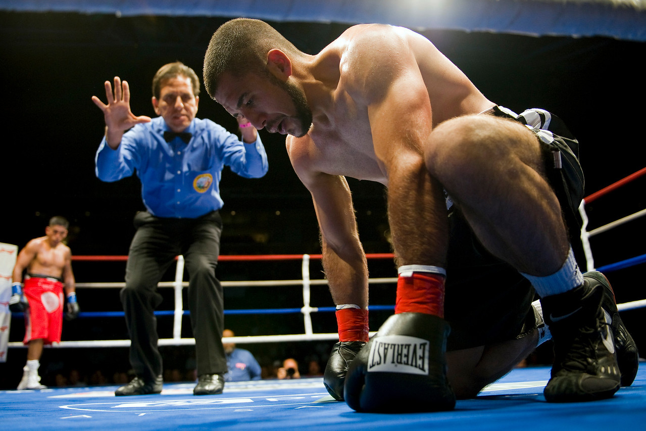 16 July 2009: Clint Coronel (blue tape) watches as Tony Juarez (red tape) gets counted out during American Metal & Iron Fight Night at the Tank at HP Pavilion in San Jose, CA.  Coronel defeated Juarez in a third round TKO.