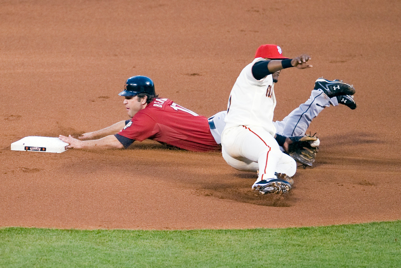 03 July 2009:  Houston Astros first baseman Lance Berkman (17) slides into second base safely ini front of San Francisco Giants third baseman Juan Uribe (5) after stealing on a wild pitch in the fourth inning during the Giants' 13-0 win over the Astros at AT&T Park in San Francisco, CA.