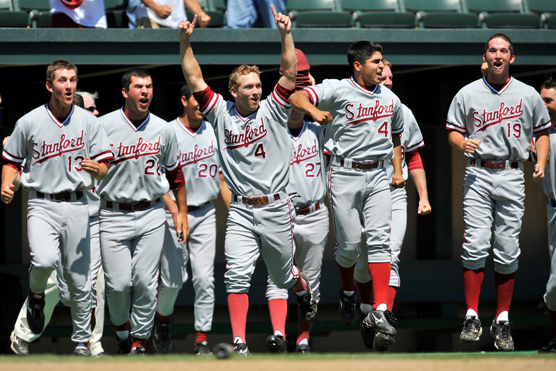 02 June 2008:  Stanford Cardinal players Colin Walsh (13), Danny Sandbrink (28), Jeffrey Inman (20), Austin Yount (4), Blake Hancock (27), Erik Davis (19), and student manager Rey Saldana (41) celebrate Sean Ratliff's (not pictured) fifth inning grand slam during Stanford's come-from-behind 9-7 win over Pepperdine at Klein Field at Sunken Diamond in Stanford, CA.  Ratliff's slam, his second home run of the game, gave the Cardinal the lead for the first time in the game after trailing 6-2 in the fourth.