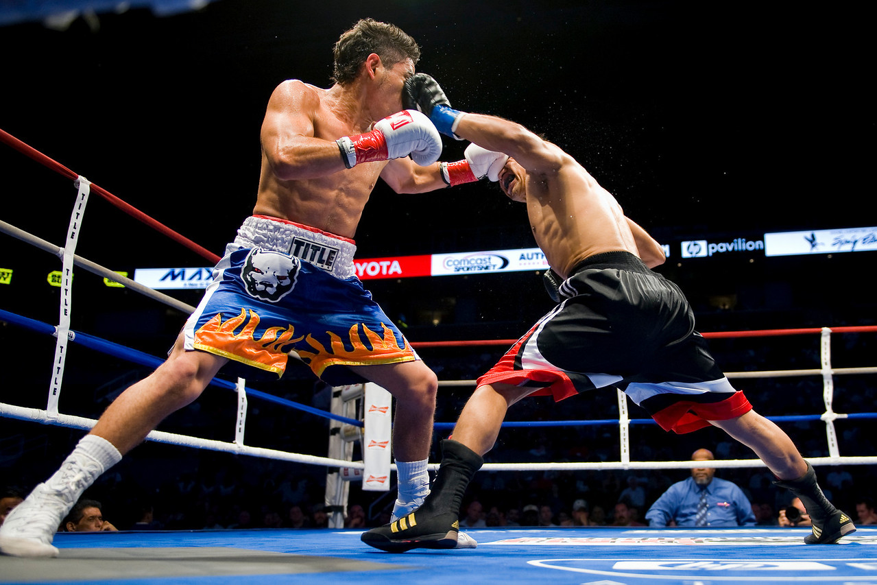 16 July 2009: Juan Topoz (blue tape) and Jonathan Alcantara (red tape) during American Metal & Iron Fight Night at the Tank at HP Pavilion in San Jose, CA.  Topoz defeated Alcantara in a split decision.