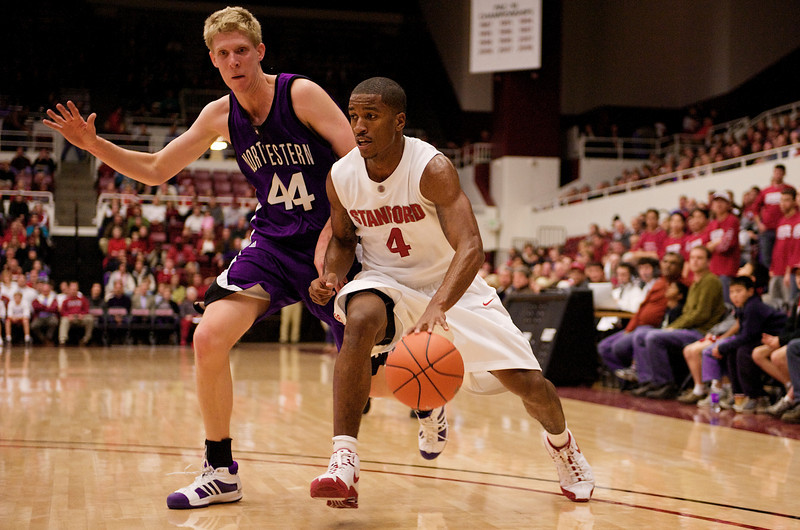 20 December 2008: Stanford Cardinal guard Anthony Goods (4) dribbles past Northwestern Wildcats forward Kevin Coble (44) during the first half of the Cardinal's 65-59 win over the Wildcats at Maples Pavilion in Stanford, California.