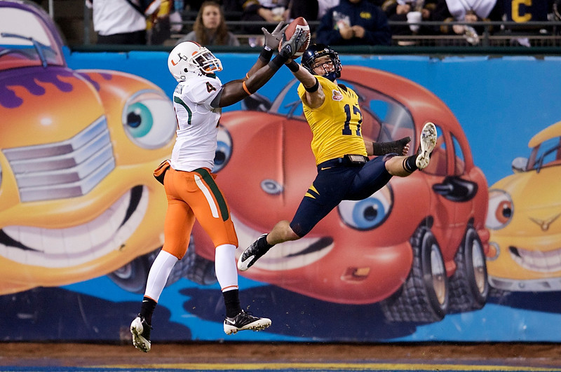 27 December 2008:  California Golden Bears cornerback Chris Conte (17) leaps to deflect a pass intended for Miami Hurricanes wide receiver Aldarius Johnson (4) during the second half of the Golden Bears' 24-17 victory over the Hurricanes in 2008 Emerald Bowl at AT&T Park in San Francisco, California.