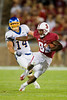 19 September 2009:  Stanford wide receiver Chris Owusu (81) catches a pass in front of San Jose State linebacker Travis Jones (14) during the third quarter of the Cardinal's 42-17 win over the Spartans at Stanford Stadium, in Stanford, CA.