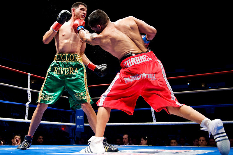 07 May 2009:  Clint Coronel (red trunks) trades punches with Ruben Rivera (green trunks) during their fight at American Metal & Iron Fight Night at the Tank: The Next Chapter at HP Pavilion in San Jose, CA.  The fight was scored a unanimous draw.