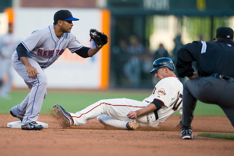 17 May 2009:  New York Mets left fielder Fernando Tatis (17) receives the throw at second base just ahead of San Francisco Giants first baseman Travis Ishikawa (10) during the Giants' 2-0 win over the Mets at AT&T Park in San Francisco, CA.