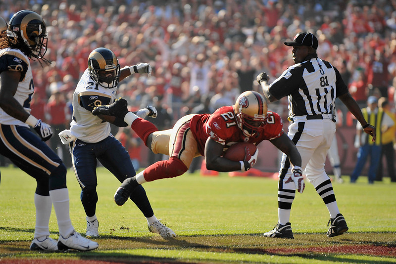 Nov. 16, 2008; San Francisco, CA, USA; San Francisco 49ers running back Frank Gore (21) dives into the endzone for a touchdown during the first quarter of the 49ers game against the St. Louis Rams at Candlestick Park. Mandatory Credit: Daniel R. Harris-US PRESSWIRE