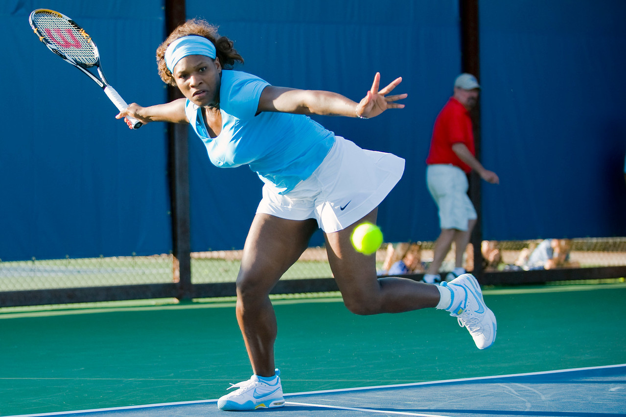 27 July 2009:  Serena Williams (USA) and Venus Williams (not pictured) during their 6-4, 6-2 victory over Yi Chen (TPE) and Mashona Washington (USA) in their doubles match at the Bank of the West Classic in Stanford, CA.
