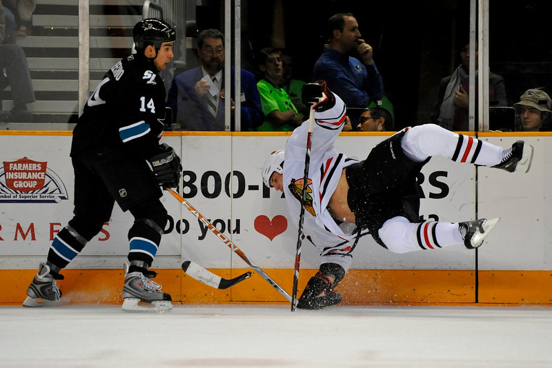 26 November 2008:  San Jose Sharks right wing Jonathan Cheechoo (14) checks Chicago Blackhawks left wing Andrew Ladd (16) who breaks his stick during the first period of the Sharks game against the Blackhawks at HP Pavillion in San Jose, California.  **** Editorial Usage Only *****