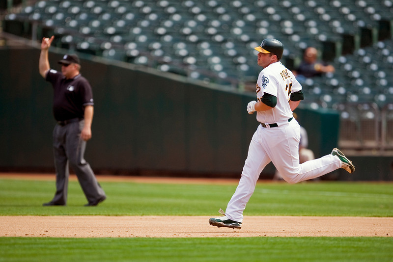 02 September 2009:  Oakland Athletics catcher Landon Powell (35) rounds first base after hitting a grand slam in the second inning during the Athletics' 10-4 win over the Kansas City Royals at Oakland-Alameda County Coliseum in Oakland, CA.