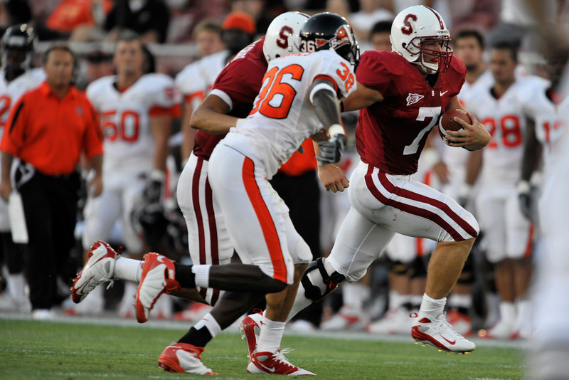 28 August 2008: Running back Toby Gerhart (7) runs toward the end zone as cornerback Brandon Hughes (36) tries to make the tackle during the Stanford Cardinal's 36-28 victory over the Oregon State Beavers at Stanford Stadium in Stanford, CA.