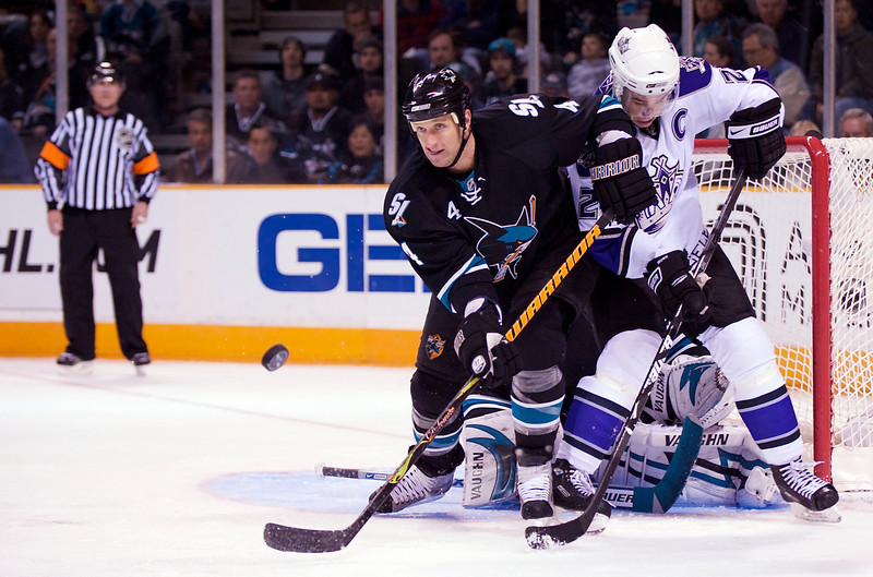 19 February 2009:  San Jose Sharks defenseman Rob Blake (4) blocks a shot in front of Los Angeles Kings right wing Dustin Brown (23) during the Sharks' 4-2 win over the Kings at HP Pavillion in San Jose, California.  **** Editorial Usage Only *****