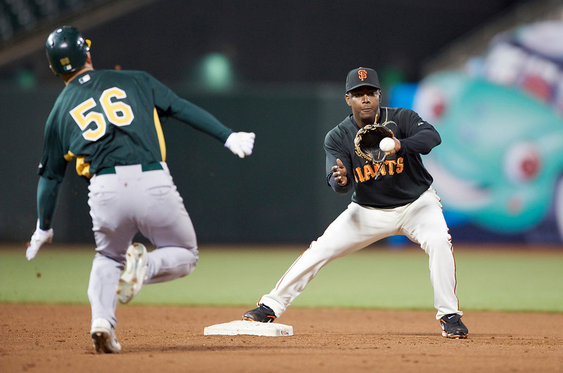 02 April 2009:  Oakland Athletics shortstop Cliff Pennington (56) heads toward San Francisco Giants shortstop Edgar Renteria (16) as Renteria receives the throw during the Giants' 7-4 exhibition game victory over the Athletics at AT&T Park in San Francisco, CA.