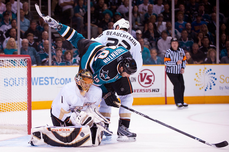 19 April 2009:  San Jose Sharks center Joe Thornton (19) dives for a puck over Anaheim Ducks goalie Jonas Hiller (1) and defenseman Francois Beauchemin (23) during the second period of the Ducks' 3-2 win over the Sharks in Game 2 of the 2009 Stanley Cup Western Conference Quarterfinal Playoffs at HP Pavilion in San Jose, CA.