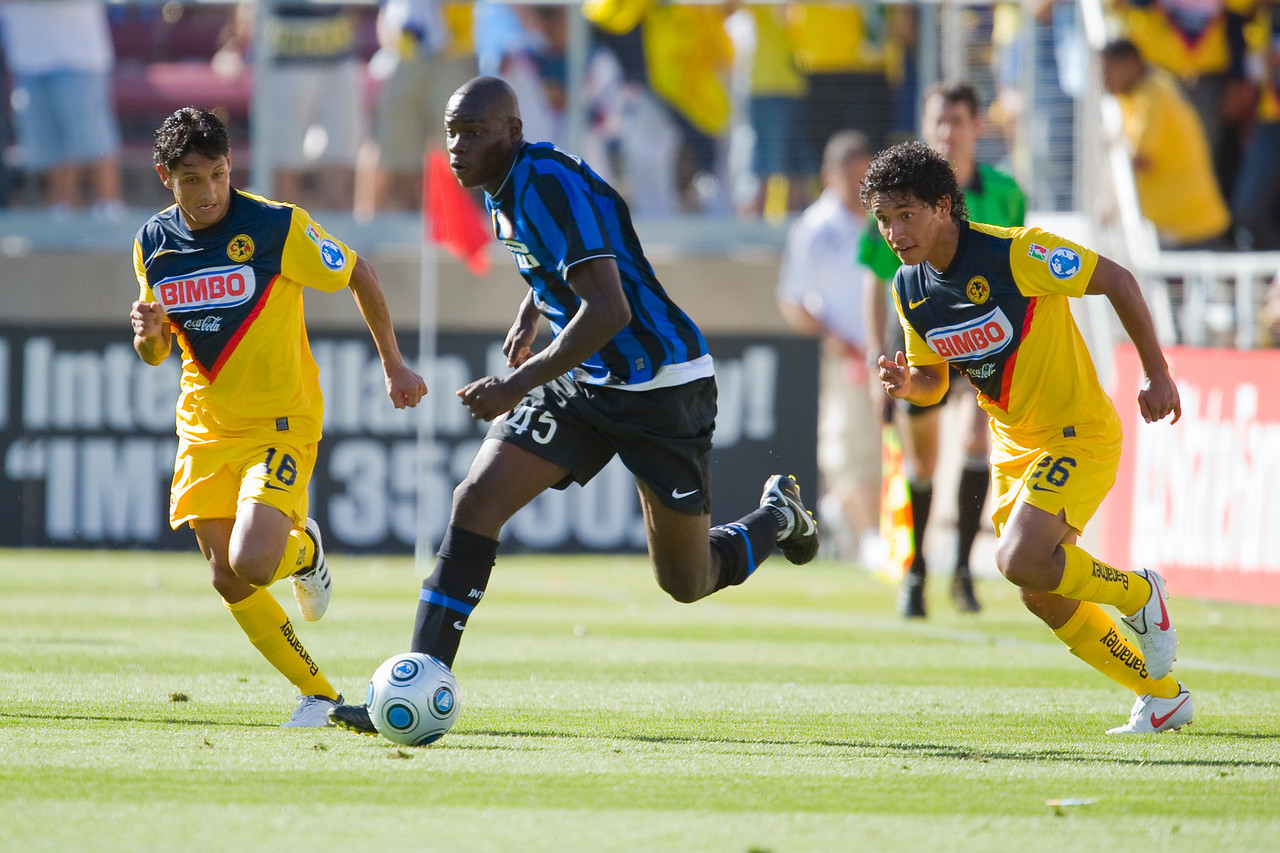 19 July 2009:  Inter Milan forward Mario Balotelli (45) dribbles in front of Club America midfielder Angel Eduardo Reyna (18) during play in the World Football Challenge match between Club America and Inter Milan at Stanford Stadium in Stanford, California.  Club America prevailed 1-1 on penalty kicks.
