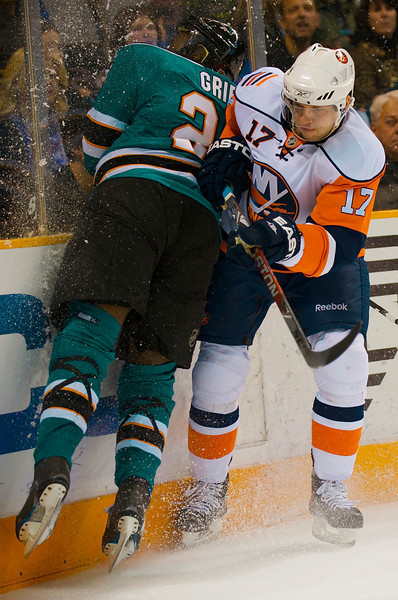 03 January 2009:  New York Islanders defenseman Thomas Pock (17) checks San Jose Sharks right wing Mike Grier (25) into the boards during the second period of the Sharks 5-3 win over the Islanders at HP Pavillion in San Jose, California.  **** Editorial Usage Only *****