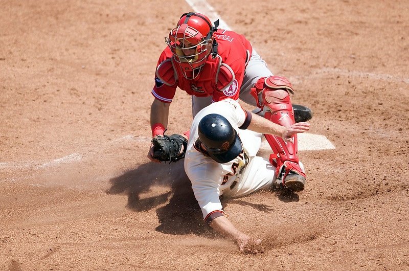 17 June 2009:  San Francisco Giants second baseman Matt Downs (37) slides into home plate where he is tagged out by Los Angeles Angels catcher Jeff Mathis (5) during the seventh inning of the Angels' 4-3 win over the Giants at AT&T Park in San Francisco, CA.