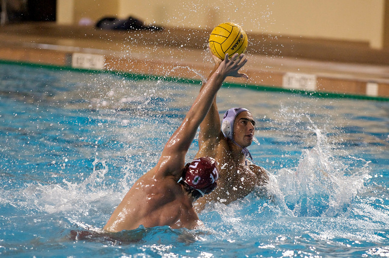 06 December 2008: Stanford Cardinal driver Alex Pulido (17)  blocks a shot from Loyola Marymount Lions driver Tibor Forai (6) during the Cardinal's 6-5 win over the Lions in the NCAA men's water polo championship semi-final game at the Avery Aquatic Center in Stanford, CA.