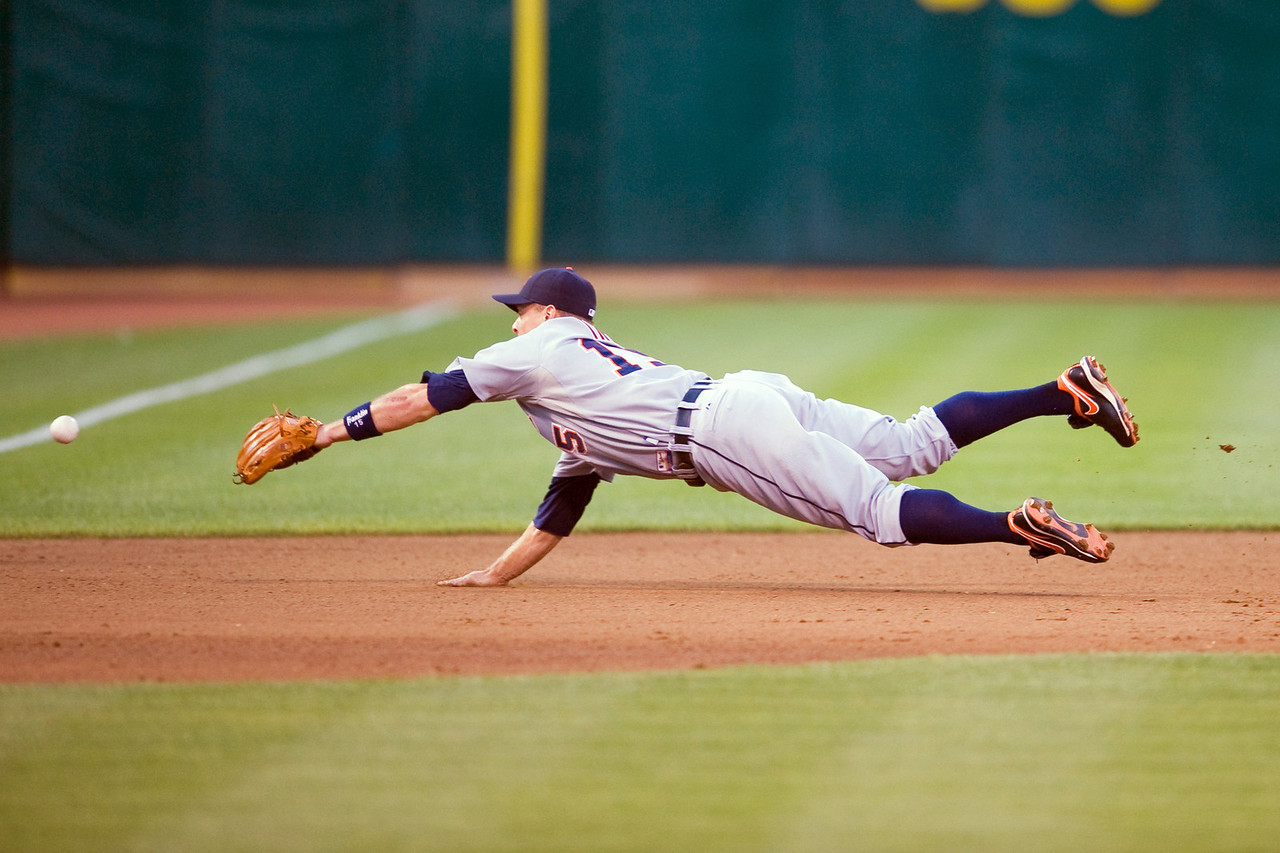 29 June 2009:  Detroit Tigers third baseman Brandon Inge (15) dives for a ground ball out of his reach during the Oakland Athletics' 7-1 win over the Tigers at the Oakland-Alameda County Coliseum in Oakland, CA.