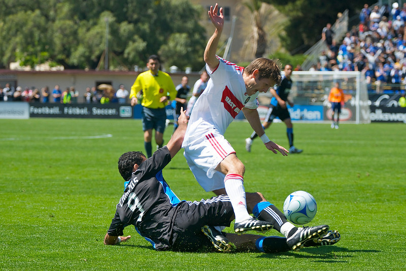 11 April 2009:  San Jose Earthquakes forward Pablo Campos (9) tackles Chicago Fire defender Brandon Prideaux (6) during the Earthquakes' 3-3 tie with the Chicago Fire at Buck Shaw Stadium in Santa Clara, CA.