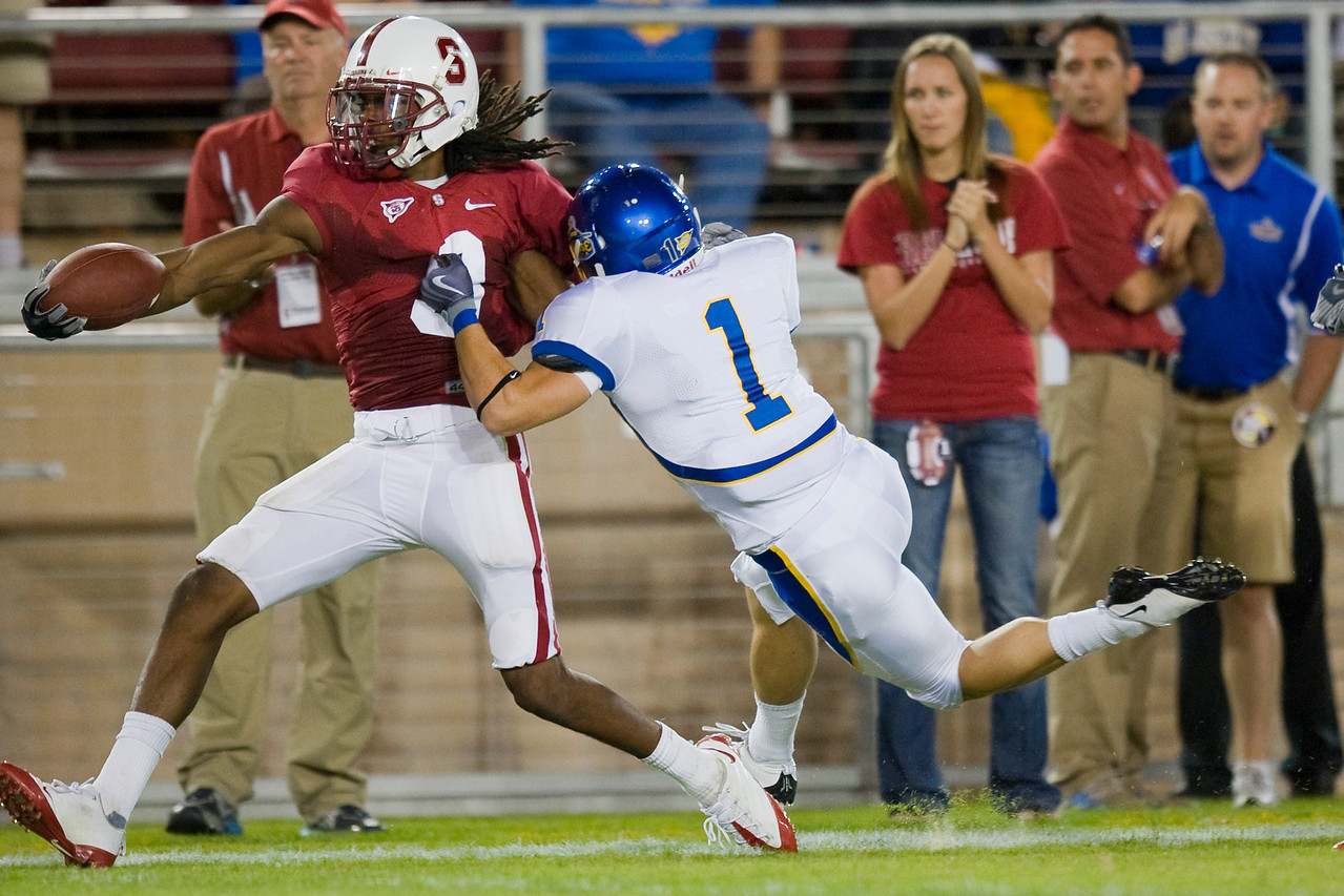 19 September 2009:  Stanford wide receiver Drew Terrell (9) runs a punt return into the end zone for a touchdown past San Jose State wide receiver Josh Harrison (1) during the Cardinal's 42-17 win over the Spartans at Stanford Stadium, in Stanford, CA.
