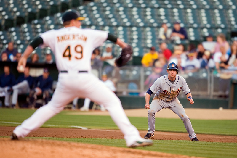 29 June 2009:  Oakland Athletics starting pitcher Brett Anderson (49) pitches as Detroit Tigers shortstop Adam Everett (4) leads off first base during the Athletics' 7-1 win over the Tigers at the Oakland-Alameda County Coliseum in Oakland, CA.