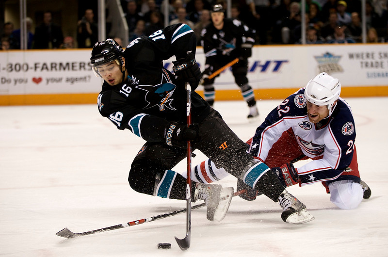 04 December 2008: Columbus Blue Jackets defenseman Mike Commodore (22) trips San Jose Sharks right wing Devin Setoguchi (16) during the second period of the Sharks 3-2 win over the Blue Jackets at HP Pavillion in San Jose, California.  **** Editorial Usage Only *****