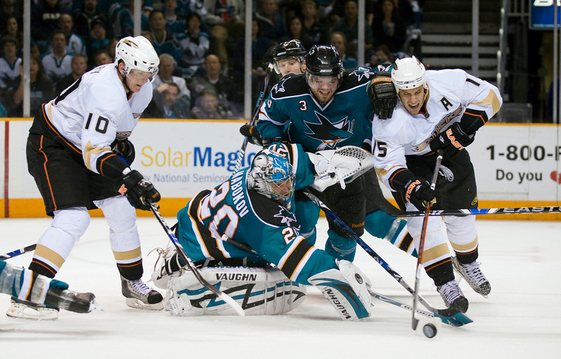 25 April 2009:  San Jose Sharks defenseman Douglas Murray (3) and goalie Evgeni Nabokov (20) defend against Anaheim Ducks center Ryan Getzlaf (15) during the third period of the Sharks' 3-2 overtime win over the Ducks in Game 5 of the 2009 Stanley Cup Western Conference periodfinal Playoffs at HP Pavilion in San Jose, CA.