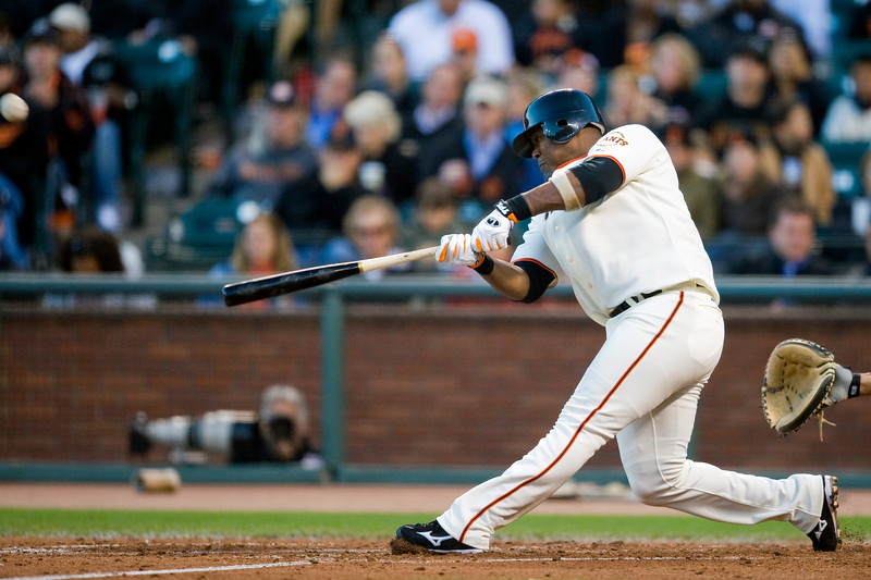 07 July 2009:  San Francisco Giants third baseman Juan Uribe (5) hits a home run in the fifth inning during the Giants' 3-0 win over the Florida Marlins at AT&T Park in San Francisco, CA.
