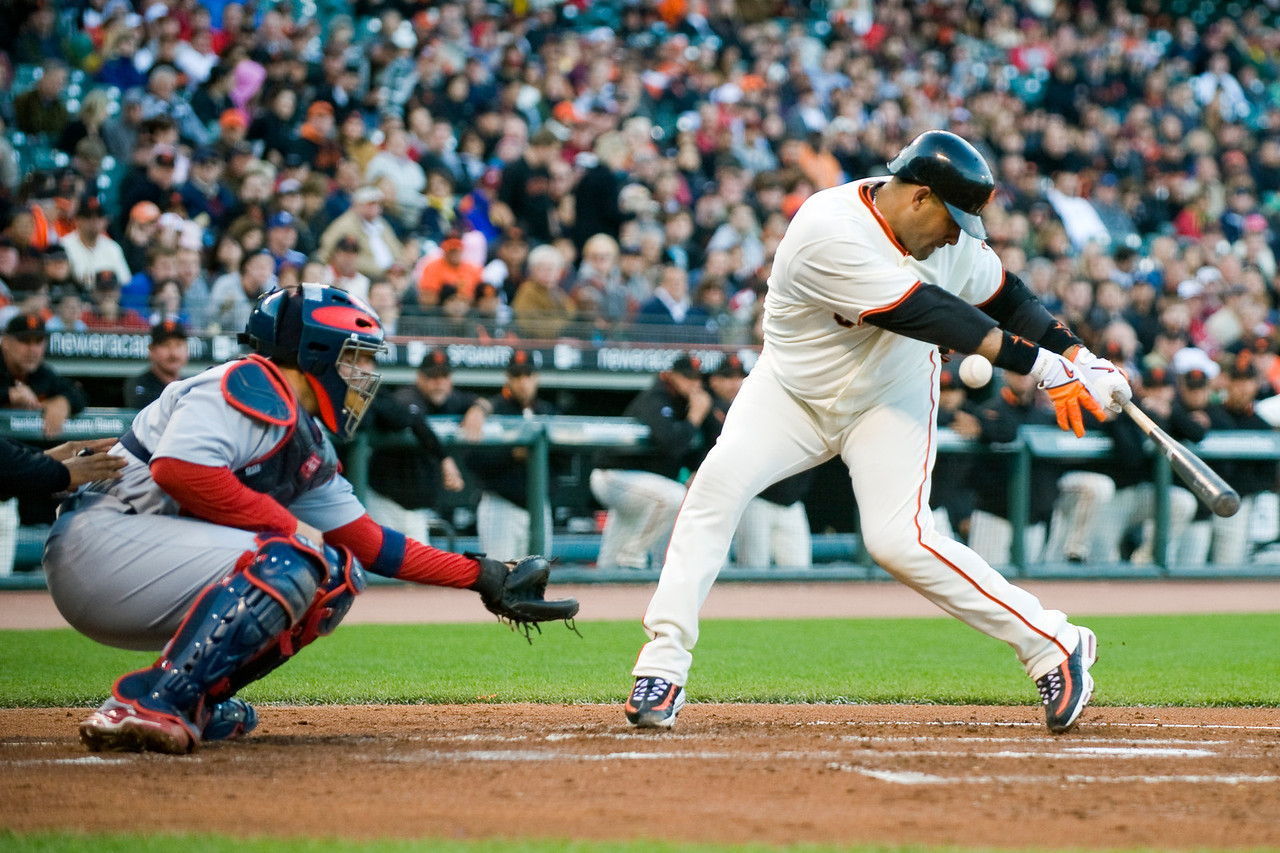 29 May 2009:  San Francisco Giants catcher Bengie Molina (1) gets hit by a ball in front of his brother St. Louis Cardinals catcher Yadier Molina (4) during the Giants' 4-2 win over the Cardinals at AT&T Park in San Francisco, CA.