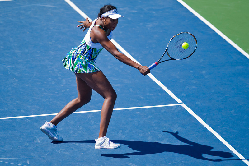 29 July 2009:  Venus Williams (USA) and Serena Williams (not pictured) during their 6-1, 6-0 victory over Liga Dekmeijere (LAT) and Julie Ditty (USA) in their doubles match at the Bank of the West Classic in Stanford, CA.